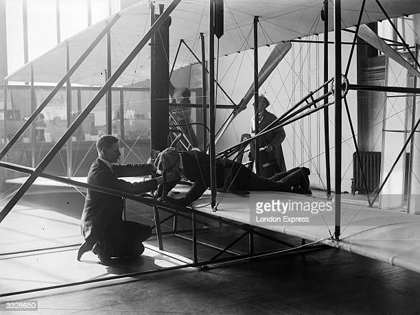 Dummy figure is fitted into the Wright brothers' biplane in preparation for exhibition at the Science Museum, in South Kensington, London. The...