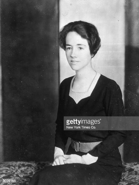Portrait of Anne Morrow Lindbergh wife of American aviator Charles Lindbergh sitting with her hands in her lap