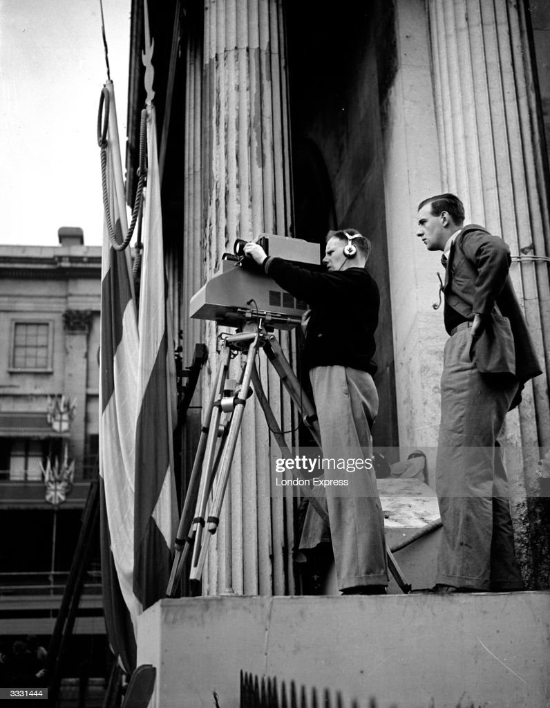 A cameraman filming the coronation of George VI.
