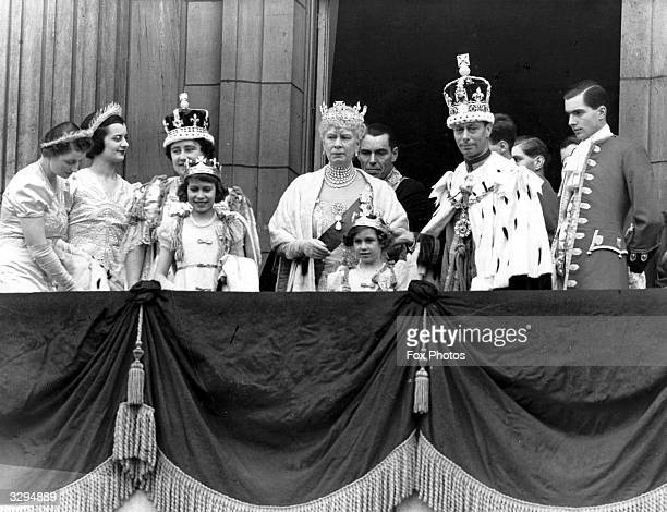 King George VI , and Queen Elizabeth on the balcony of Buckingham Palace after their Coronation ceremony with the Royal Princesses, Elizabeth and...