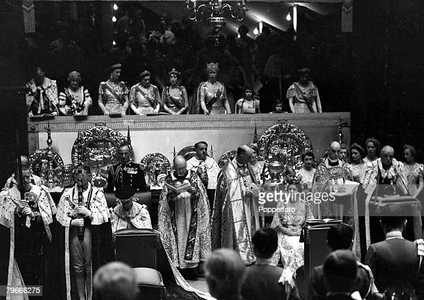12th May 1937 London England King George VI and Queen Elizabeth later the Queen Mother in their chairs of state watched by other members of the royal...