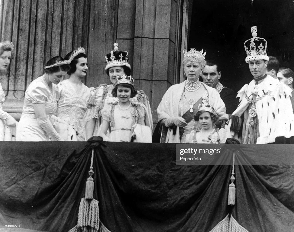 12th May 1937, London, England, Members of the Royal Family on the Buckingham Palace balcony after the Westminster Abbey Coronation, showing the crowned King George VI and Queen Elizabeth, later the Queen Mother, with Queen Mary (centre) and Princess Eliz : News Photo