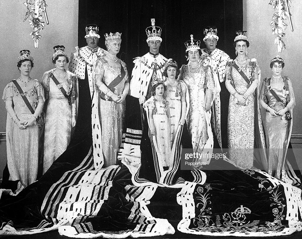 12th May 1937, London, England, The Royal Family pose for a formal group photograph in their coronation robes for the coronation of King George VI and Queen Elizabeth, later the Queen Mother, pictured in Buckingham Palace