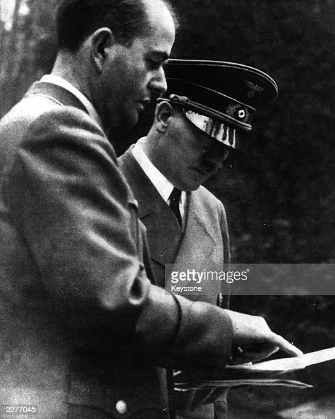 German dictator Adolf Hitler in conversation with architect Albert Speer Nazi Minister for War Production about the progress of the 'Atlantic Wall'
