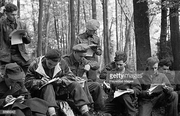 Liberated British Prisoners of War, safely back in England, send telegrams to their loved ones before being paid and kitted out for 42 days' leave....