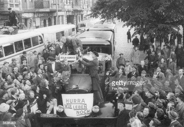 First cars starting for Hanover in the west after the ending of the Berlin blockade A notice on a car reads 'Hurrah we are still alive'