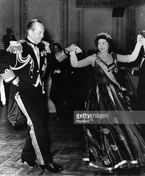 King Paul I of the Hellenes , King since 1947, with his wife Queen Frederika at a charity ball in Athens.