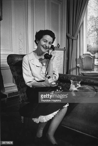 English writer Nancy Mitford speaking on the telephone in her apartment in Paris. One of the essayists in 'Noblesse Oblige', edited by herself, she...