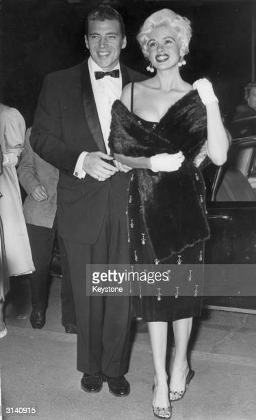 Hollywood sex symbol Jayne Mansfield and her husband Mickey Hargitay smile for the cameras at the Cannes film festival