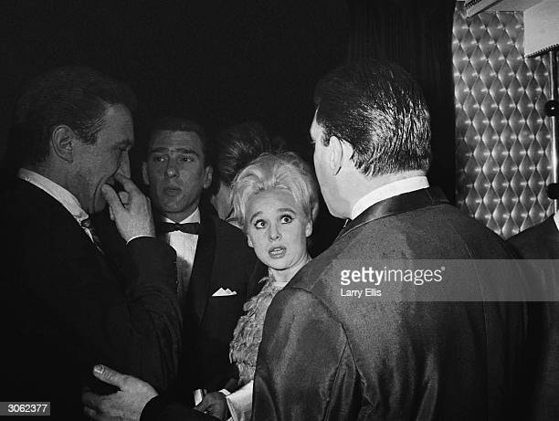 From left to right actor George Sewell London gangster Reggie Kray actress Barbara Windsor and Reggie's brother Ronnie Kray at the El Morocco...