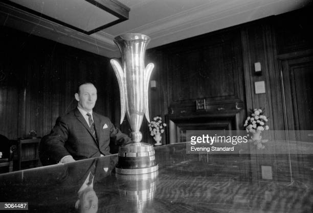 Bertie Mee the manager of Arsenal football club with the Fairs Cup which the team won after beating Anderlecht 30 at Highbury