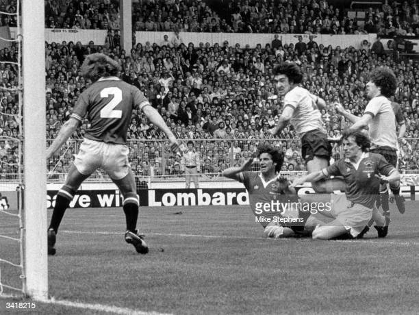 Arsenal's Brian Talbot puts the ball past Manchester United's Jimmy Nicholl to score his team's first goal during the FA Cup Final at Wembley Stadium...