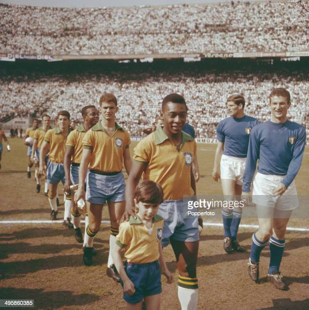 Pele leads the Brazil national team out on to the pitch before the international game with Italy at the San Siro stadium in Milan, Italy on 12th May...