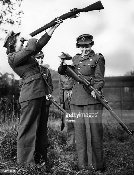 ATS girls cleaning their rifles at the Miniature Rifle Club at a West Country Transport depot The rifles are service weapons adapted for small bore...