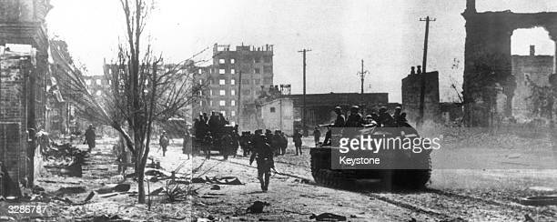 German storm artillery offers 'rolling' cover to the infantry as they enter the ruined suburbs of Stalingrad the devastation being the result of the...