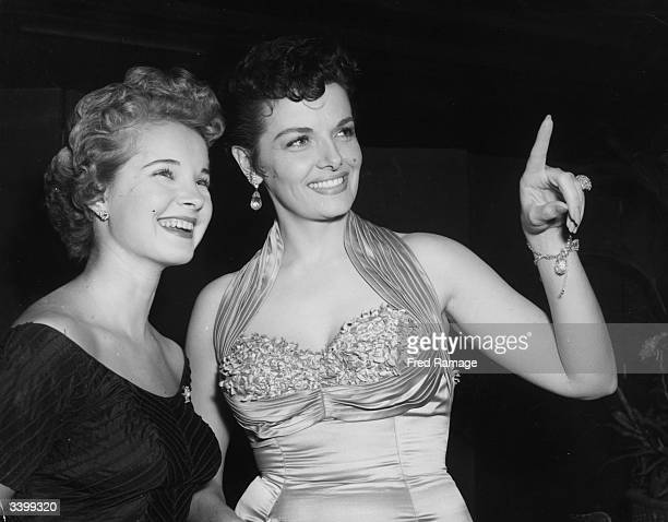 American actresses Mona Freeman and Jane Russell are just two of the international stars at a reception at the Empire Theatre, Leicester Square,...