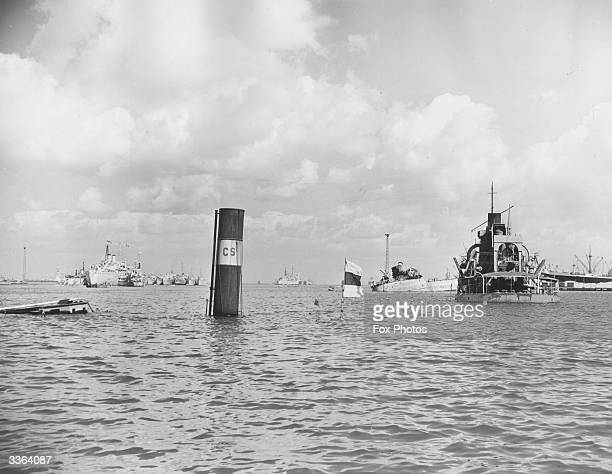 A flag and funnel are the only visible remains of a blockship that has been sunk in the Suez Canal at Port Said Egypt during the Suez Crisis