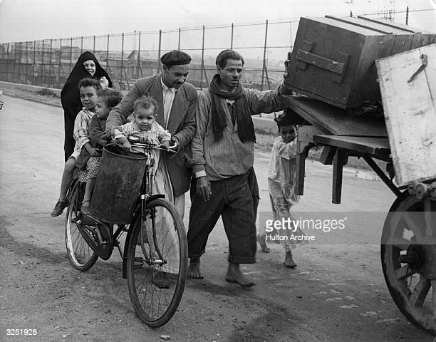 Arab refugees leave Port Said after its capture by French and British forces.