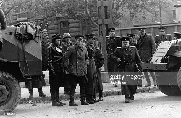 Russian soldiers in Budapest during the uprising The officer is drawing his pistol on Picture Post photographer Jack Esten to dissuade him from...