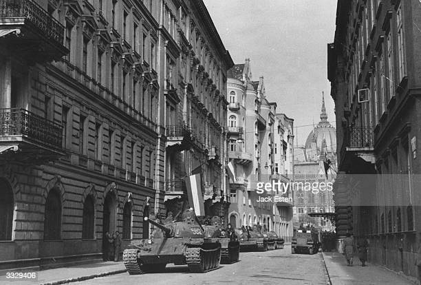 Russian tanks roll through the streets of Budapest during Russian action against Hungary's anticommunist uprising Original Publication Picture Post...
