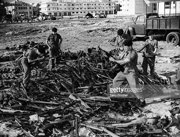 Soldiers in Port Said examining an arms find during the Suez Crisis