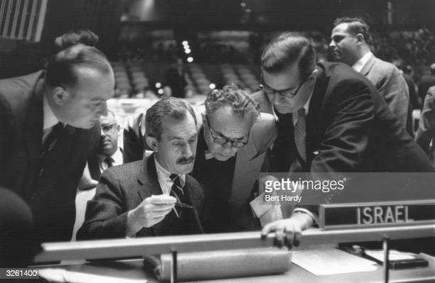 The Israeli delegation at the United Nations studies a document during the Suez Crisis Original Publication Picture Post 8731 Pub 1956