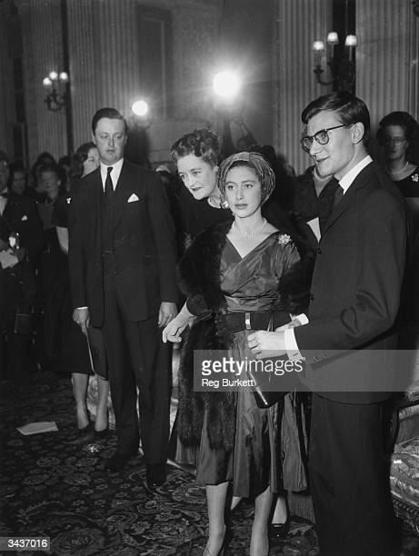 Princess Margaret with dress designer Yves St Laurent after she had presented him with the British Red Cross Society's Badge of Honour after the...