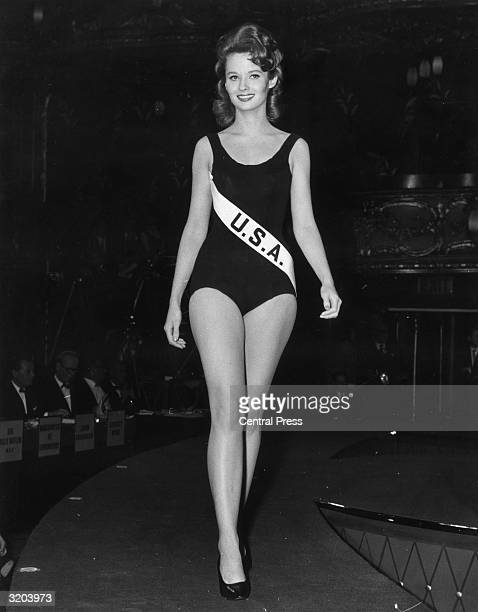 Jeanne Quinn Miss USA strides down the catwalk in front of a panel of judges during the Miss World beauty pageant held at the Lyceum Ballroom London