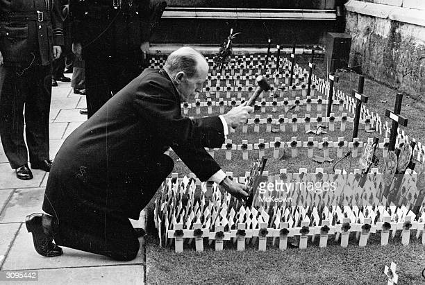 A rectangle of miniature crosses being planted outside Westminster Abbey London on Remembrance Day to commemorate those who died in the two world wars