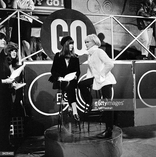 French pop singer Sylvie Vartan on the set of television programme 'Ready Steady Go' with the show's presenter Cathy McGowan