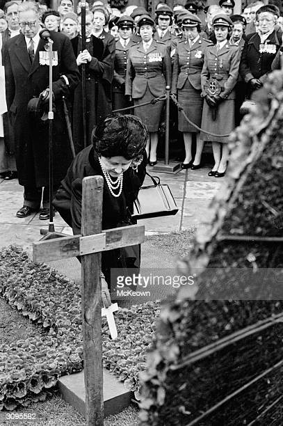 The Queen Mother plants a miniature cross outside Westminster Abbey London on Remembrance Day to commemorate those who died in the two world wars