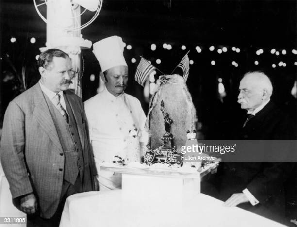 Auguste Escoffier right known as 'the chef of Emperors and the Emperor of chefs' on board the 'Berengaria' in New York with the ship's chefs and an...