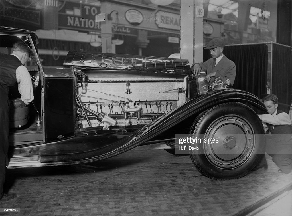 During preparations for a forthcoming motor show at Olympia, a ...