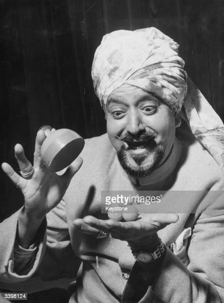 Indian magician Gogia Pasha doing a trick during a preview of the Twelfth Annual Magic Festival of the Magic Circle at the Scala Theatre in London