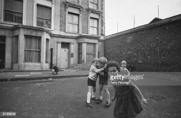 Children playing outside 10 Rillington Place London the home of the mass murderer John Christie