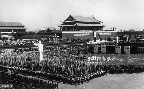 Over a million Red Guards, carrying flags and a huge statue of Chairman Mao, at the 1st of October celebrations in Beijing.