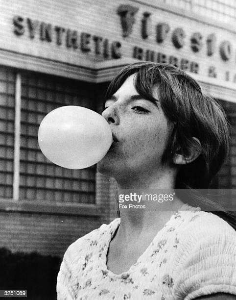 Lisa Cernik a 13 year old champion bubble gum blower demonstrates her talent outside the Firestone Rubber Company in Akron Ohio where the ingredient...