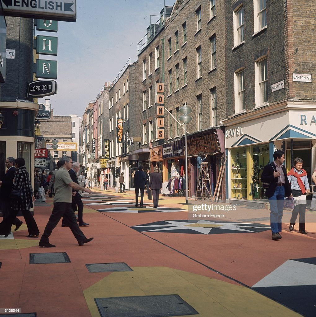 London's fashionable Carnaby Street, featuring new rubberised, coloured paving tiles; part of Westminster City Council's ?60,000 face-lift for the pedestrianised street, which, with its trendy boutiques, has become a major tourist attraction.