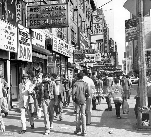 Shoppers on West 42nd Street between 7th and 8th Avenues in the Times Square area of New York