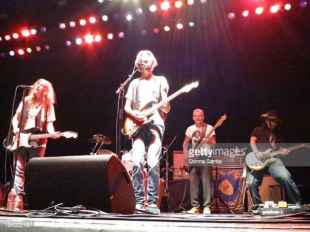 Patti Smith performs live on stage with guitarist Lenny Kaye bassist Flea and Johnny Depp during the encore at the Wiltern Theatre in Los Angeles on...