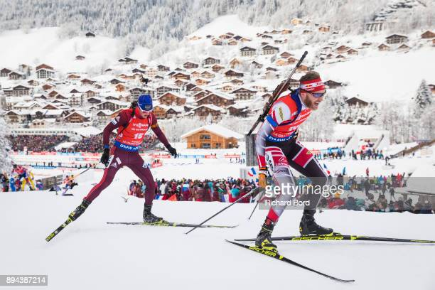 12th place Simon Eder of Austria and 13th place Anton Babikov of Russia compete during the IBU Biathlon World Cup Men's Mass Start on December 17,...