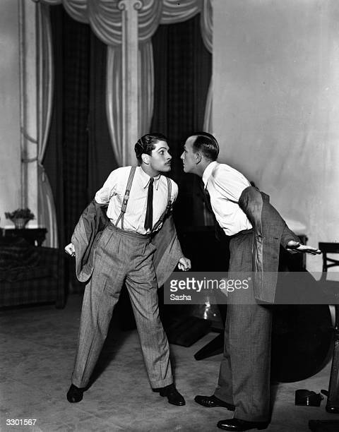 Laurence Olivier and Noel Coward preparing for a fight in a scene from the play 'Private Lives' at the Phoenix Theatre London