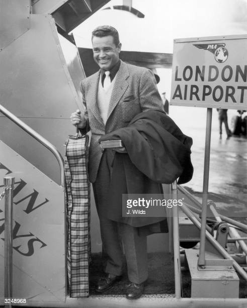 American actor Tom Neal arrives at London Airport to pay a visit to actress Barbara Payton A year earlier he and Franchot Tone had fought over Payton...