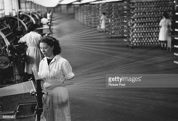 Workers at a nylon factory in Pontypool South Wales Threads of nylon are being spun onto spools Original Publication Picture Post 6701 Picture Post...