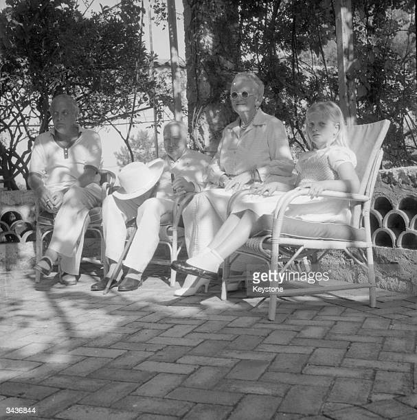 Left to right Randolph Churchill his father Sir Winston Churchill Lady Churchill and granddaughter Arabella celebrating Sir Winston and Lady...