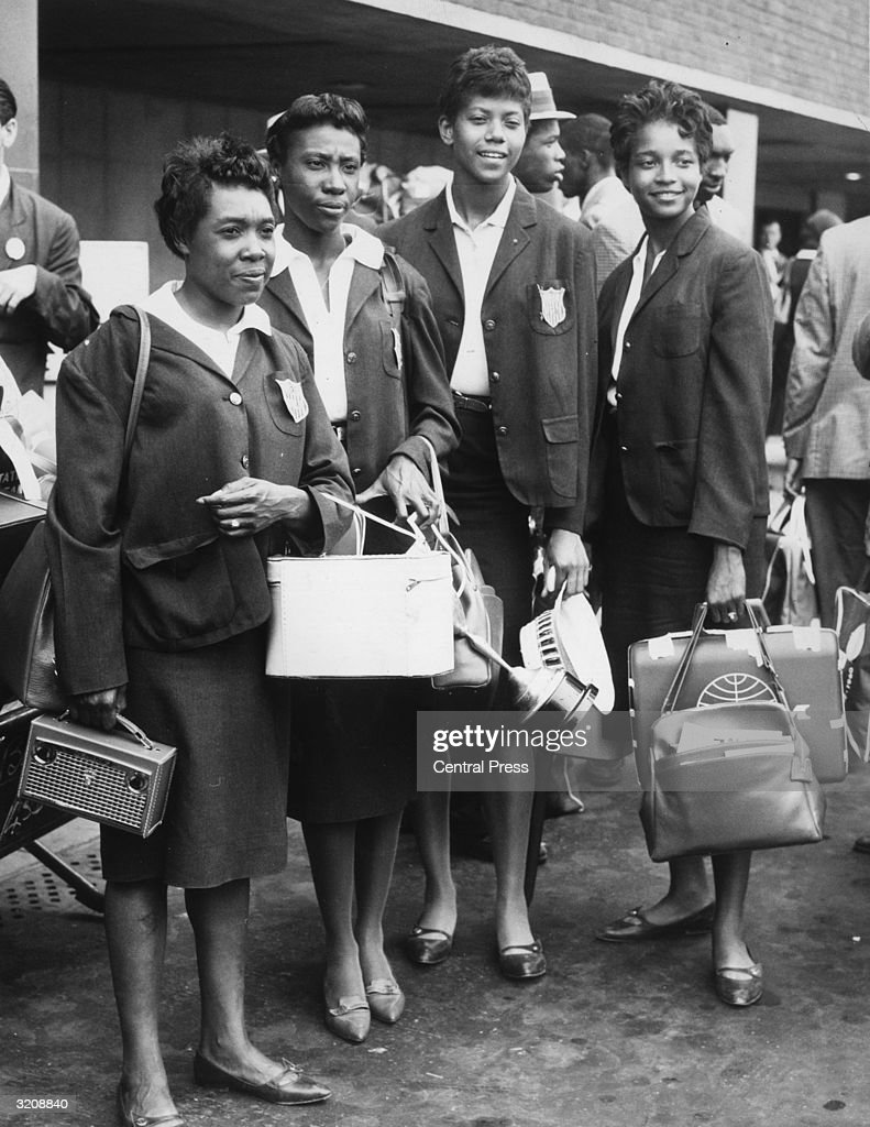 The 'Tennessee Tiger Belles', the American athletic team who collected three gold medals in the 1960 Olympic Games, arrive at London Airport from Rome for the Commonwealth versus USA athletics meeting at White City. From left to right, they are Martha Hudson, Lucinda Williams, Wilma Rudolph and Barbara Jones.