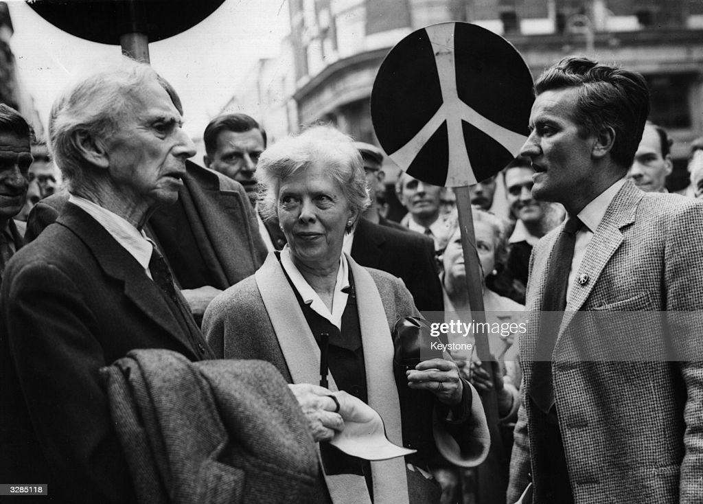 89 year old philosopher Earl Russell talking with a member of his committee, George Clark, during a break in his hearing at Bow Street Court, where he was sent to jail for inciting the public to take part in a demonstration against nuclear weapons.