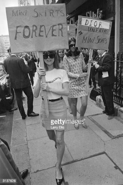 Girls from the British Society for the Protection of Mini Skirts stage a protest outside the House of Dior for its 'unfair' treatment of mini skirts