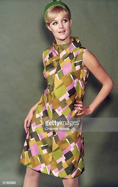 A model wearing a figurehugging minidress which is zip fastened up the front