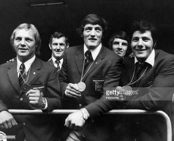 Britain's judo team left to right Brian Jacks Dave Starbrook and Angelo Parisi return to Britain with the medals they won competing in the Munich...